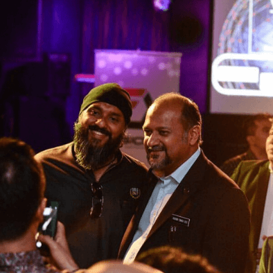 Teacher Raj taking a photo with YB Gobind Singh