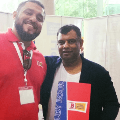 Teacher Raj take a photo with Tan Sri Tony Fernandes of Air Asia
