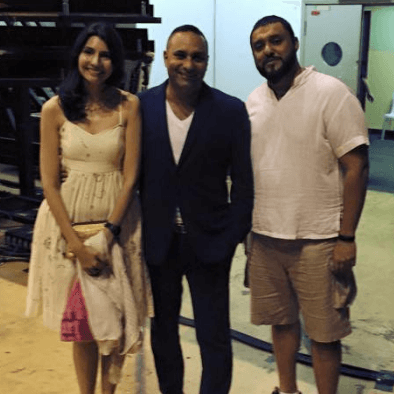 Teacher Raj and wife takes a photo with Russel Peters
