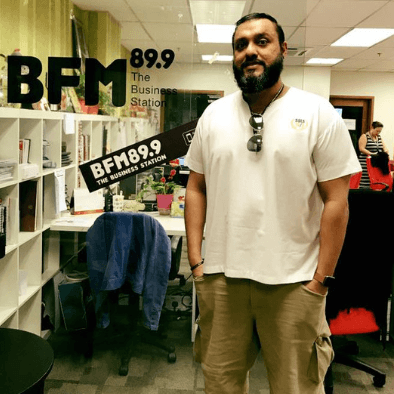 Teacher Raj posing for a photo at the BFM office